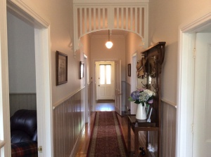Central hallway with hall stand adds to the character of Camellia Cottage