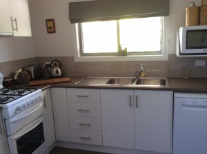 Kitchen with gas cooking, dishwasher, microwave & has everything you'll need for your stay
